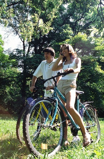 Couple with bikes : Stock Photo