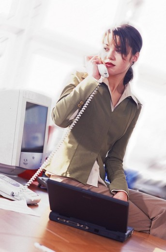 Stock Photo: 4123-9621 Woman talking on the phone