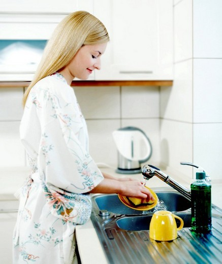Woman washing plate : Stock Photo