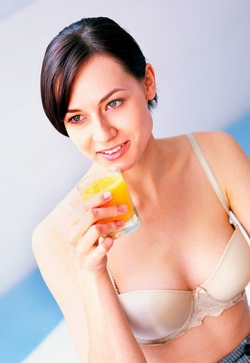 Stock Photo: 4123-9920 Woman drinking juice