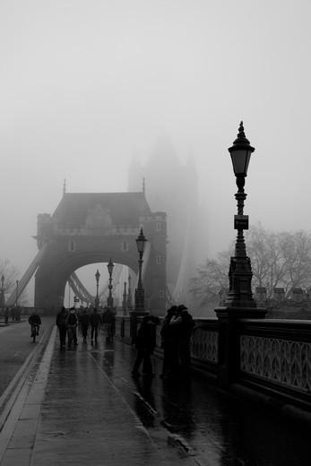 Tourists on a bridge, Tower Bridge, Thames River, London, England : Stock Photo
