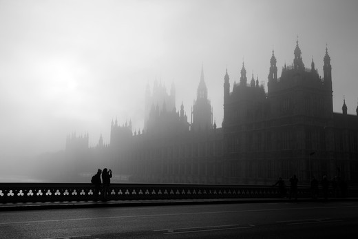Bridge with fog covered Houses of Parliament in the background, Westminster Bridge, London, England : Stock Photo