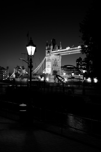 Bridge lit up at night, Tower Bridge, St. Katharine Docks, Wapping, London, England : Stock Photo