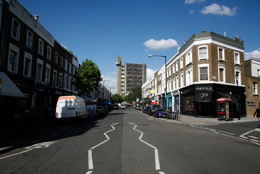 Buildings along a street, Golborne Road, Trellick Tower, North Kensington, London, England : Stock Photo