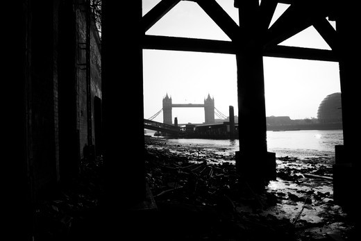 Bridge viewed from under a jetty, Tower Bridge, Thames River, City of London, London, England : Stock Photo