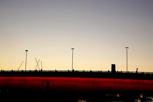 Commuters walking across a bridge, London Bridge, City of London, London, England : Stock Photo