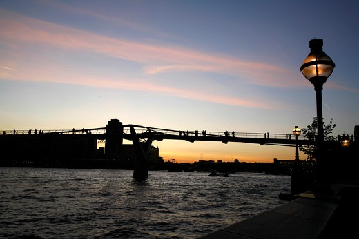 Bridge across a river at dusk, Millennium Bridge, Thames River, City of London, London, England : Stock Photo