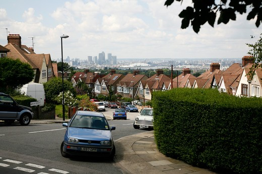 Distant view of Millennium Dome and Canary Wharf from Brinklow Crescent on Shooters Hill, London, UK : Stock Photo
