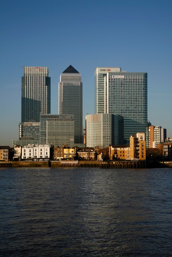 Buildings at waterfront, Thames River, Canary Wharf, Docklands, London, England : Stock Photo