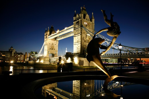 Dolphin statue in front of a bridge, Tower Bridge, Thames River, City of London, London, England : Stock Photo