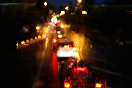 Trail of traffic during rainy evening rush hour on Putney Hill, Putney, London, UK : Stock Photo