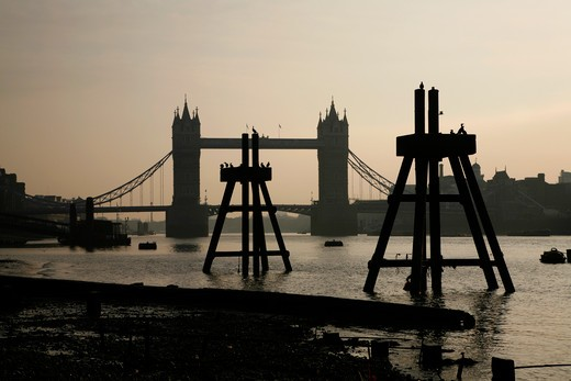 Tower Bridge seen from the foreshore of the River Thames at low tide, City of London, UK : Stock Photo