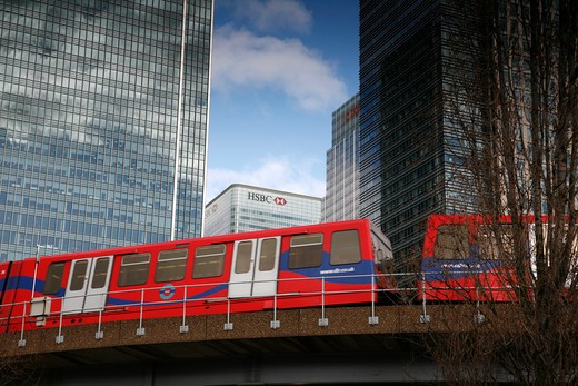 DLR train passing in front of the HSBC Building, Canary Wharf, London, UK : Stock Photo