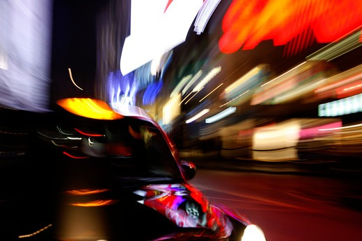 London taxi driving through Piccadilly Circus in London's West End, UK : Stock Photo