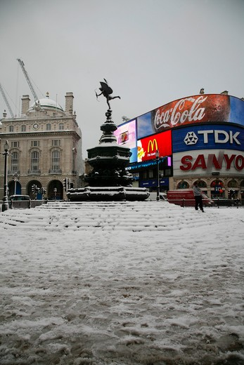 Snow-covered Eros fountain in Piccadilly Circus, London, UK : Stock Photo