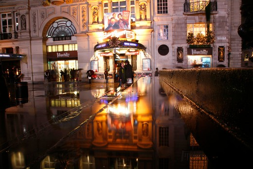 Rainy reflections of Criterion Theatre from the steps of Eros, Piccadilly Circus, London, UK : Stock Photo