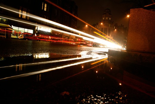 Light trails emanating from traffic driving down the Brompton Road, Brompton, London, UK : Stock Photo