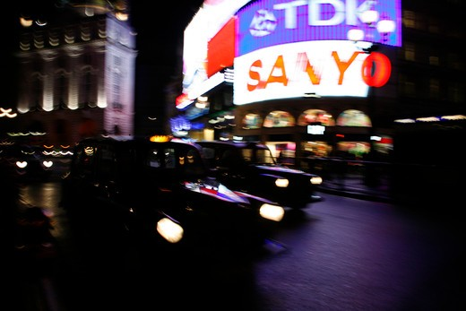 Couple of London taxis driving through Piccadilly Circus in London's West End, UK : Stock Photo