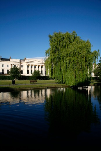 Reflection of a building on water, Boating Lake, Regents Park, Cornwall Terrace, Marylebone, London, England : Stock Photo