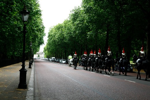 Household Cavalry (Blues and Royals) ride up Constitution Hill, Green Park, St James's, London, England : Stock Photo