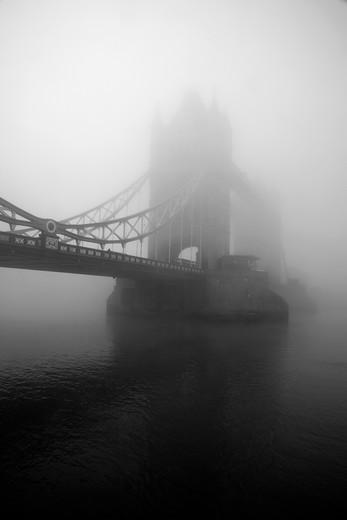 UK, London, City of London, Tower Bridge shrouded in fog : Stock Photo