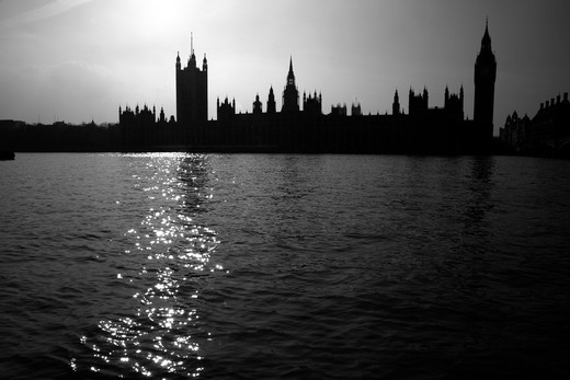UK, London, Looking across River Thames to Houses of Parliament silhouetted against afternoon sun : Stock Photo
