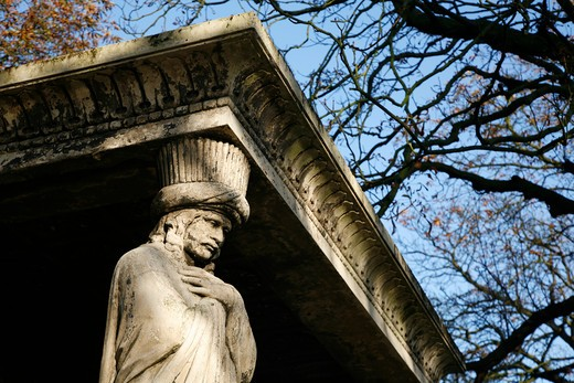 UK, London, Kensal Green, Telamon standing guard at one of corners of tomb of Major General William Casement in Kensal Green Cemetery : Stock Photo