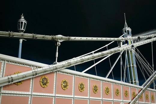 UK, London, Battersea, Albert Bridge lit up against stormy sky : Stock Photo