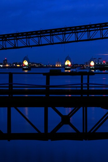 UK, London, Woolwich, Looking through industrial conveyor belts at Angerstein Wharf down River Thames to Thames Barrier : Stock Photo