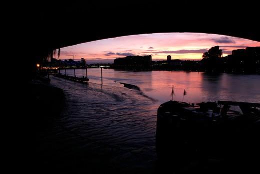 UK, London, Battersea, View under Cremorne Railway Bridge down River Thames at dusk to Battersea Reach and Wandsworth Bridge : Stock Photo