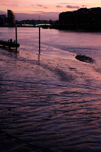 UK, London, Battersea, View down River Thames at dusk to Battersea Reach and Wandsworth Bridge : Stock Photo