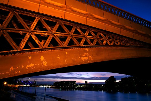 UK, London, Battersea, View under Cremorne Railway Bridge down River Thames at dusk to Battersea Reach and Wandsworth Bridge : Stock Photo