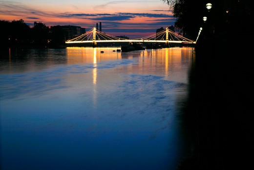 UK, London, Chelsea, View at dusk up River Thames to Albert Bridge : Stock Photo
