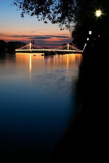 UK, London, Chelsea, View at dusk up River Thames to Albert Bridge : Stock Photo