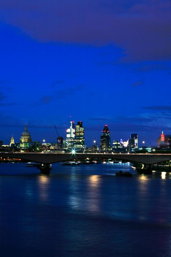 UK, London, Looking across Waterloo Bridge at dusk to St. Paul's Cathedral and City of London : Stock Photo