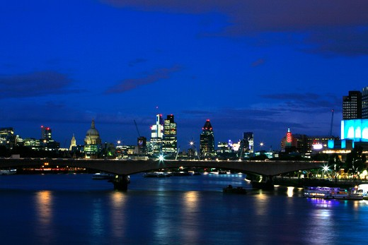 UK, London, Looking across Waterloo Bridge at dusk to St. Paul's Cathedral, City of London and South Bank : Stock Photo
