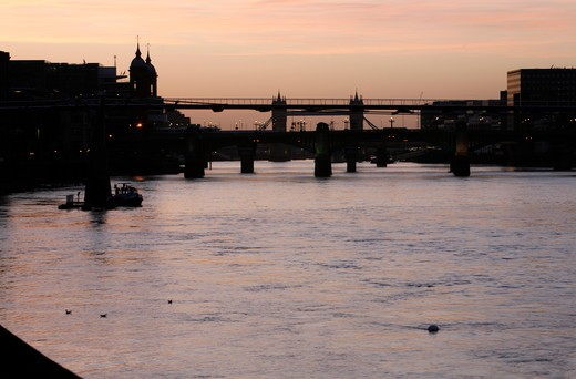 UK, London, City of London, View down River Thames at sunrise to Millennium Bridge, Southwark Bridge and Tower Bridge : Stock Photo