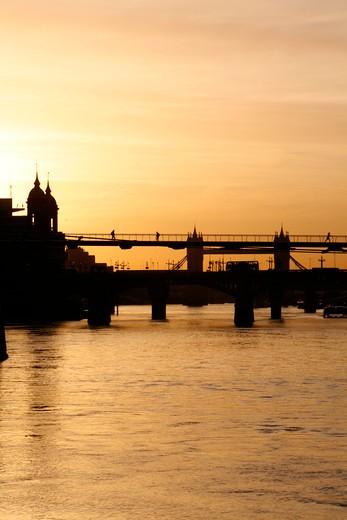 UK, London, City of London, View down River Thames at sunrise to Millennium Bridge, Southwark Bridge and Tower Bridge : Stock Photo