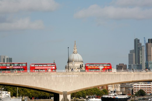 UK, London, Buses crossing Waterloo Bridge in front of St. Paul's Cathedral : Stock Photo