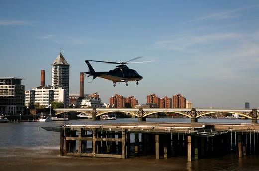 UK, London, Battersea, Helicopter landing at Battersea Heliport : Stock Photo