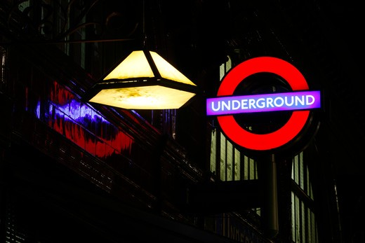 UK, London, Bloomsbury, close-up of underground sign and lamp on facade of Russell Square Tube Station : Stock Photo