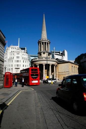 UK, London, Marylebone, Black cab and bus driving past All Souls church and Broadcasting House : Stock Photo