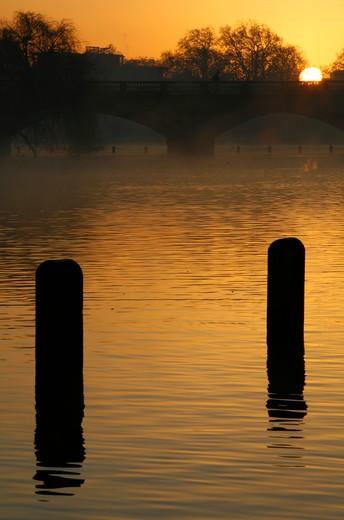 UK, London, Kensington Gardens, Sunrise on Long Water by Serpentine Bridge : Stock Photo