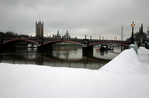 UK, London, Lambeth, View up River Thames to Lambeth Bridge and Houses of Parliament from snowbound Albert Embankment : Stock Photo