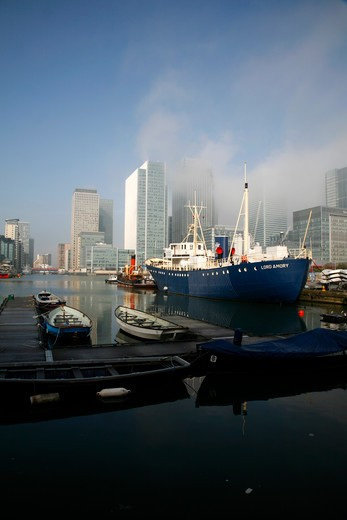 UK, London, Isle of Dogs, Misty view of Canary Wharf from West India Dock South : Stock Photo