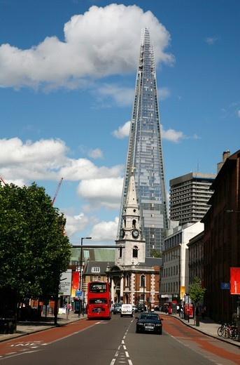 View up Borough High Street past St George The Martyr church to the Shard, London, UK : Stock Photo