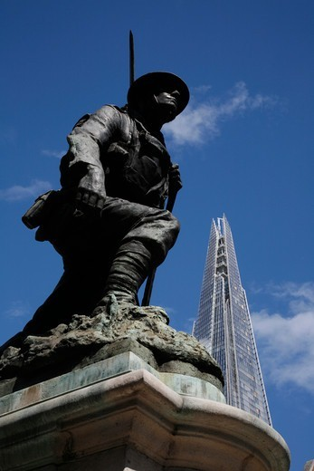 The Shard looms over World War 1 memorial to the men of St Saviour's Southwark on Borough High Street, The Borough, London, UK : Stock Photo