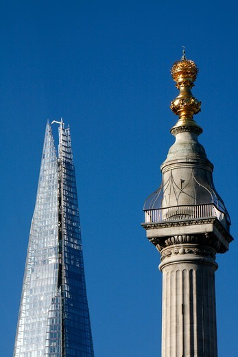 View of the Monument and the Shard, City of London, London, UK : Stock Photo