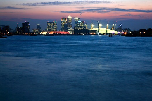 View up the River Thames at dusk from Woolwich to O2 (Millennium Dome), Emirates Airline cable car and Canary Wharf, London, UK : Stock Photo