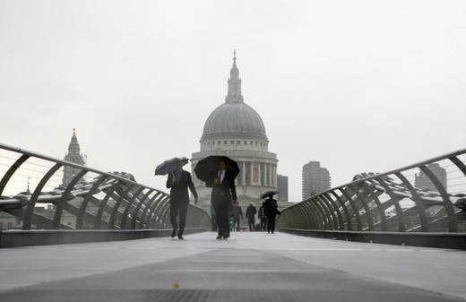 Looking across a rainy Millennium Bridge to St Paul's Cathedral, City of London, London, UK : Stock Photo